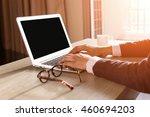 man's hands using laptop with... | Shutterstock . vector #460694203