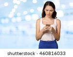 smiling beautiful woman texting ... | Shutterstock . vector #460816033