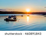 Stock photo sunset from a park in long island s cold spring harbor with boats in the water 460891843
