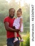 black father hugging baby... | Shutterstock . vector #461069647
