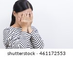 woman close her face by hand | Shutterstock . vector #461172553