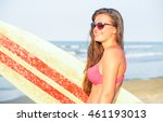 young woman holding surfing... | Shutterstock . vector #461193013