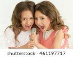 girls  singing in karaoke  | Shutterstock . vector #461197717