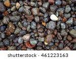 Grey Wet Pebbles On The Beach...