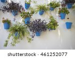 white wall with blue flower...   Shutterstock . vector #461252077