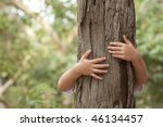 kid hans embracing a tree trunk | Shutterstock . vector #46134457