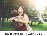 two happy young girls hug each... | Shutterstock . vector #461547913