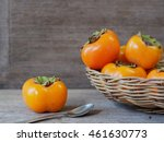Ripe Persimmon Fruit On Rustic...