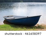 Old Rowboats On A Lake In...