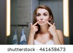 young woman checking wrinkles... | Shutterstock . vector #461658673