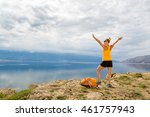 Small photo of Woman hiking or climbing success, arms outstretched looking at sea and mountains view. Accomplished climber with hands up outdoors. Beautiful inspirational landscape. Trekking and activity concept.