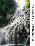 Small photo of Amazing beautiful waterfalls in tropical forest at Sarika Waterfall in Nakhonnayok, Thailand.