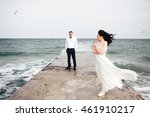 couple walking on the beach | Shutterstock . vector #461910217