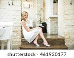 pretty blonde bride sits on the ...   Shutterstock . vector #461920177
