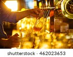 male hands poured beer from the ... | Shutterstock . vector #462023653