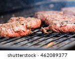 burgers cooking on a barbecue | Shutterstock . vector #462089377