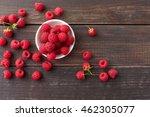 Red Fresh Raspberries On Brown...