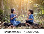 two asia girls blowing bubbles... | Shutterstock . vector #462319933