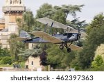 "Small photo of Old Warden, Bedfordshire, England July 31 2016. . ""The Gathering of Moths"" the annual meeting of the International Moth Club. Here a Tiger Moth is seen passing the Shuttleworth Aeronautical College."