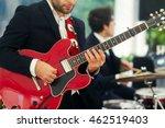 man in black suit plays red...   Shutterstock . vector #462519403