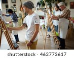Group Of Students Painting At...
