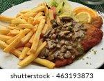 schnitzel with mushroom sauce | Shutterstock . vector #463193873