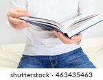 man reading a book   Shutterstock . vector #463435463