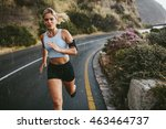 Female Athlete Running Outdoor...