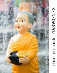 Small photo of Close up Cute Kid Thai Monk Statues of Buddhist doing Morning Alms Round.