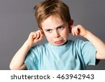 Unhappy Young Child With Red...