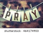 the word pray stamped on card... | Shutterstock . vector #464174903