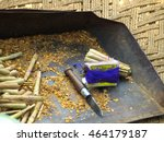 Small photo of The beedi is a thin, Indian cigarette filled with tobacco flakes and wrapped in a Bauhinia racemosa leaf and tied with a string at one end.