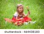 beautiful little girl picking... | Shutterstock . vector #464438183