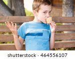 boy eating a melting ice cream. ... | Shutterstock . vector #464556107