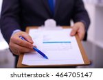 businessman holding a blank... | Shutterstock . vector #464705147