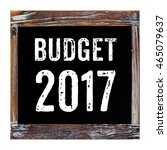 Small photo of 2017 budget word on chalkboard isolated on white background, financial concept, business strategy