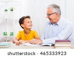 Grandfather Is Teaching His...