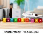 wooden cubes on light... | Shutterstock . vector #465803303