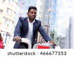 indian business man riding a... | Shutterstock . vector #466677353