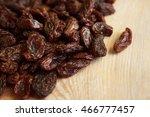 raisins on a wooden background   Shutterstock . vector #466777457