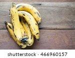 Ripe Bananas Over On Wood Tabl...