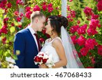 wedding couple in the flowers... | Shutterstock . vector #467068433