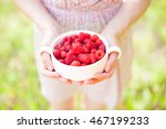 girl holding a white plate with ... | Shutterstock . vector #467199233