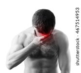 Small photo of Young adult shirtless sporty man with headache isolated on white background. Black and white stylized photo with red local ache spot
