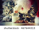 hand of santa claus picking... | Shutterstock . vector #467644313
