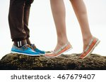 Small photo of Lady in peach shoes stand tiptoe on the stone