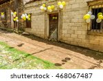 Small photo of San Juan del Obispo, Guatemala - June 24, 2016: Houses adorned with balloons & pine needle carpets in street for St John's Day procession in village named after the patron saint, near Antigua.