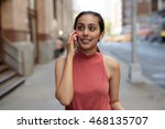 young woman in city talking on... | Shutterstock . vector #468135707