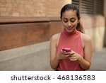young woman in city texting... | Shutterstock . vector #468136583