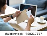 Pleasant man opening a letter